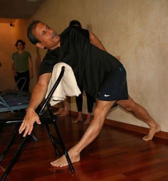 Arun parivrtta-trikonasana-with-chair